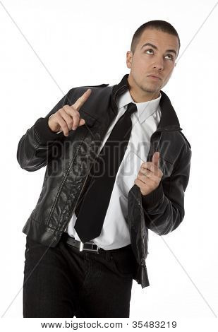 Studio photo of trendy young man looking and pointing upward on white background.