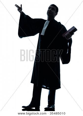 one caucasian lawyer man pleading silhouette in studio isolated on white background
