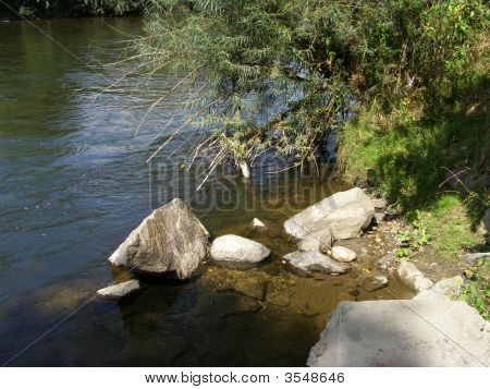 Rocks At The River Bank