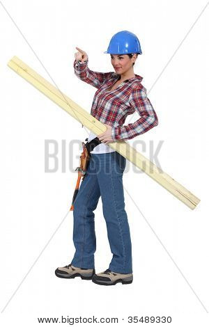 Tradeswoman holding planks of wood