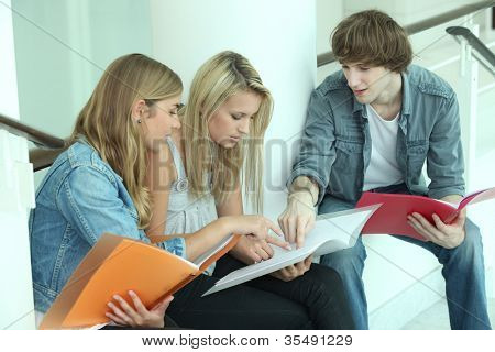 Teenagers sitting on steps