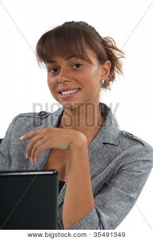 Young woman in front of a computer