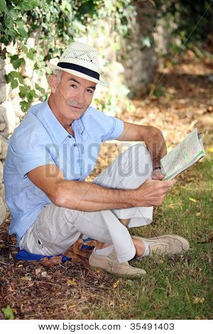 elderly gentleman reading