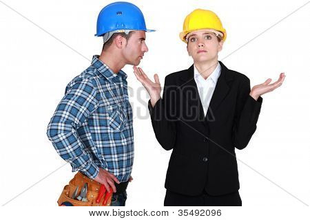 Angry foreman with helpless woman entrepreneur