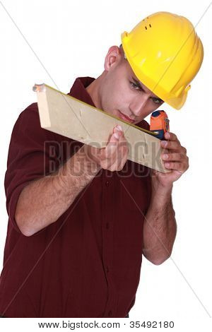 Carpenter measuring a piece of wood
