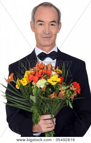 senior gentleman holding bouquet