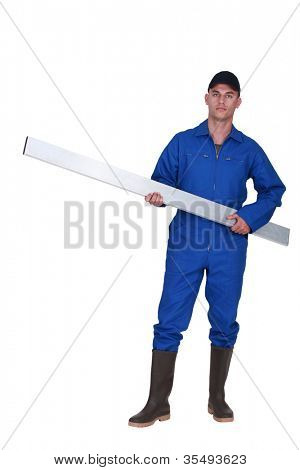 Tradesman carrying a girder