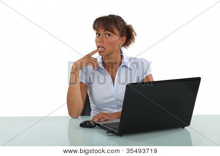 businesswoman sitting at her desk and thinking