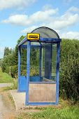picture of bus-shelter  - Small town bus stop shelter by road at summer - JPG