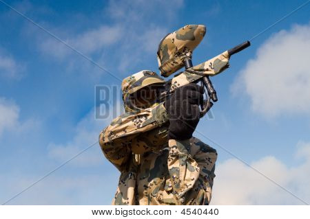 Paintball Player In Uniform Over Sky Background