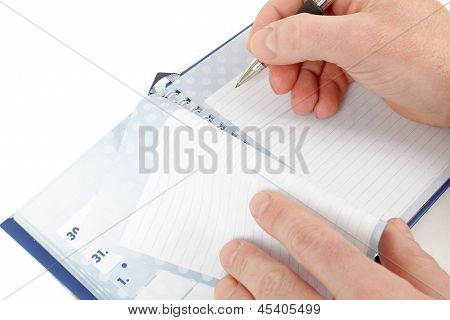 Close-up Of Hand Beginning To Write On Notes