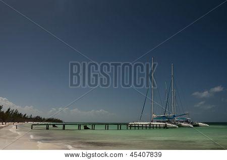 Two catamarans in port of Cayo Blanco, Cuba