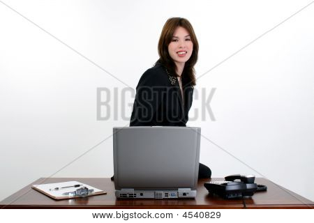 Beautiful Hispanic Woman At Desk