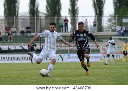 KAPOSVAR, HUNGARY - APRIL 27: Okuka Drazen (in white) in action at a Hungarian National Championship soccer game - Kaposvar (white) vs Szombathely (black) on April 27, 2013 in Kaposvar, Hungary.