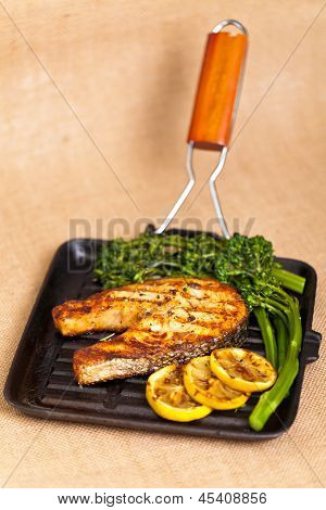 Salmon steak with broccolini