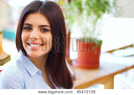 portrait of cute young business woman smiling