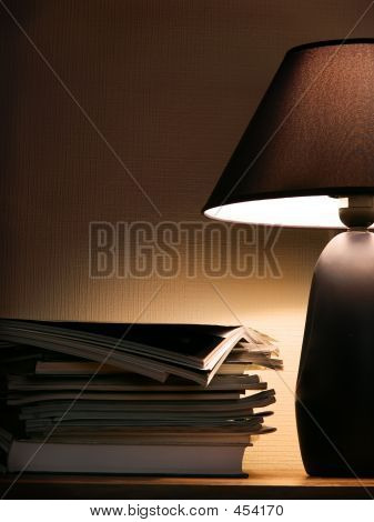 Magazines Under Evening Lamp Light