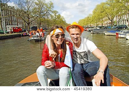AMSTERDAM, NETHERLANDS - APRIL 30: Happy couple celebrating the coronation of the new king Willem Alexander from the Netherlands on 30 april 2013