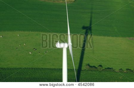Aerial View Of Windturbine And Green Meadow