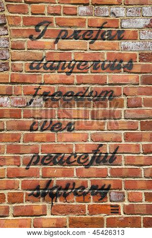 Sign on the brick wall in Brooklyn, New York. It is Thomas Jefferson quotation