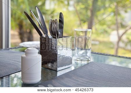 Incomplete Dining Table Setting At A Picture Window