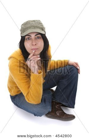 Young Casual Woman With Hat And Yellow Sweater