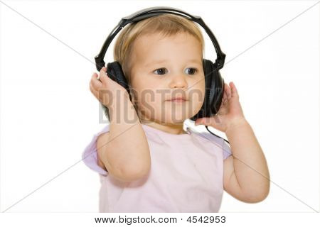 Beautiful Baby Listening To Music With Headphones.