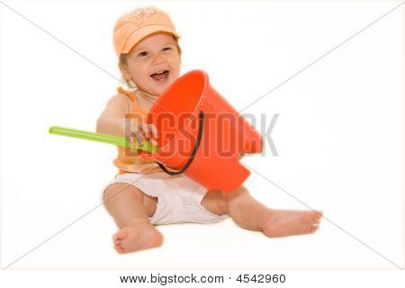 Happy Beautiful Baby With Beach Bucket And Nice Expression