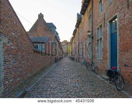 Ancient village with narrow streets at dawn in spring