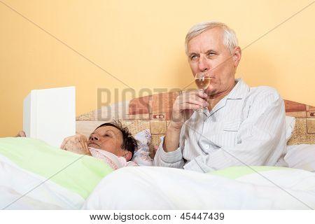 Drunk Senior In Bed