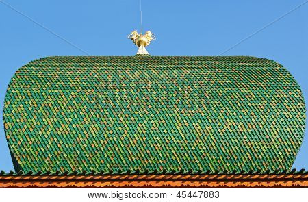 Roof Of Wooden Tiles With Attribute Of Power