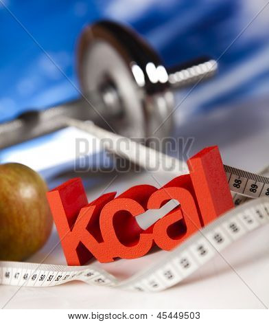 Diet and fitness, dumbell in vitamins