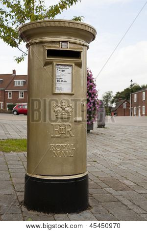 HAMBLE, NR SOUTHAMPTON, UK - AUG 8 : UK Royal Mail honours Olympic Gold Medal winners, by transforming a post box from red to gold in the home town of each gold medalist. 8 Aug 2012