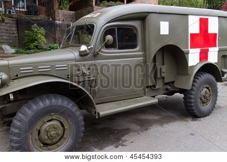 Vintage Military Ambulance In Neighborhood