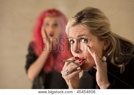 Woman Sneaking A Cigarette