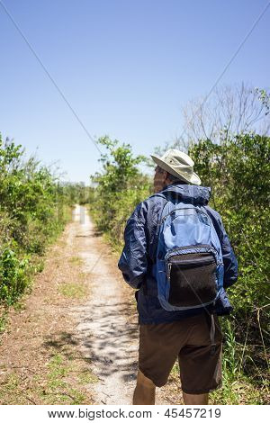 Man Hiking On A Path
