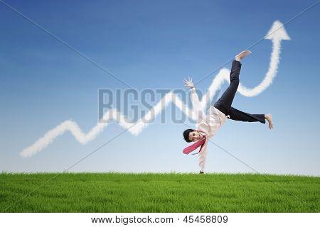 Happy Businessman Dance On Profit Chart Cloud