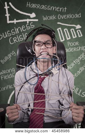 Stress Businessman Tied In Rope At Class - Vertical