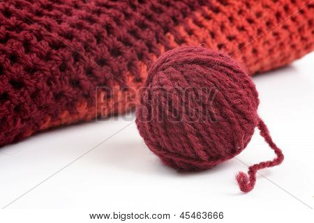 Knits And A Ball Of Wool On A White Background