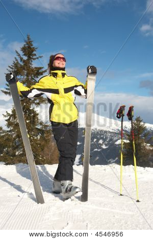 Girl With Ski In Mountain