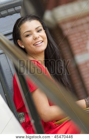 Happy Female Teenager Sitting