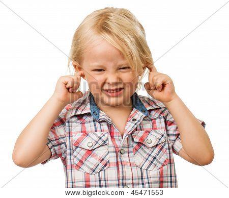 Sad boy covering his ears