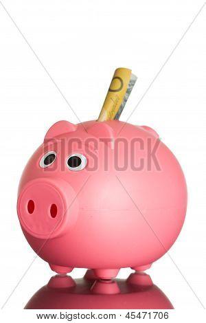 A pink piggy bank with australian money