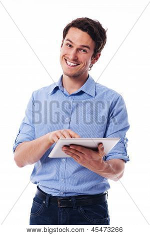 Handsome man using a digital tablet
