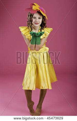 Girl With Flower On Her Head And In A Yellow Dress