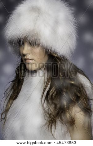 girl in fur clothing with blur foreground