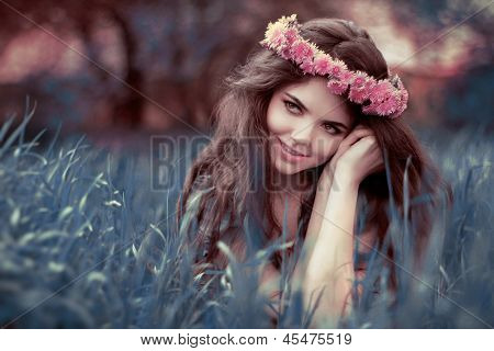 Young Beautiful Woman Resting On Grass Over Fairy Tale Park, Fairyland