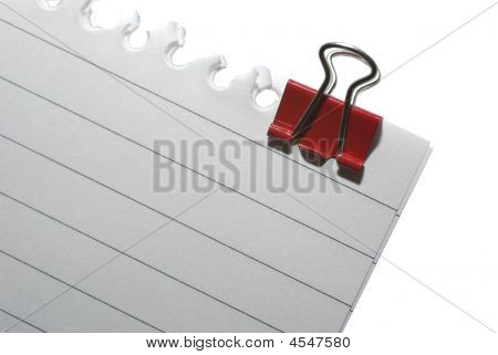 Part Of Striped Blank Notepaper With Clinch, Isolated On White. Clipping Path.