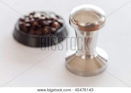Coffee Tamper And Middle Roasted Coffee Bean