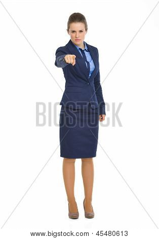 Full Length Portrait Of Serious Business Woman Pointing In Camera